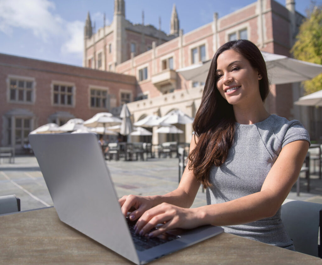 U.S. Expat entrepreneur professional working from laptop while traveling and living abroad